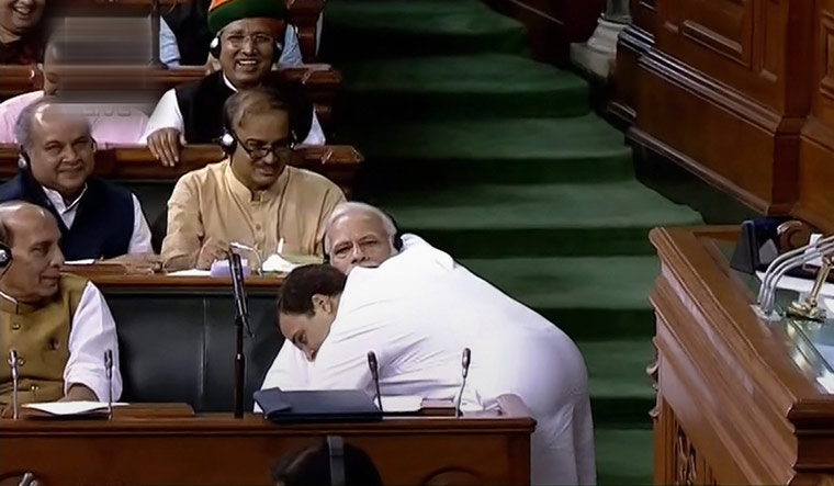Congress president Rahul Gandhi hugs Prime Minister Narendra Modi after his speech in the Lok Sabha | PTI
