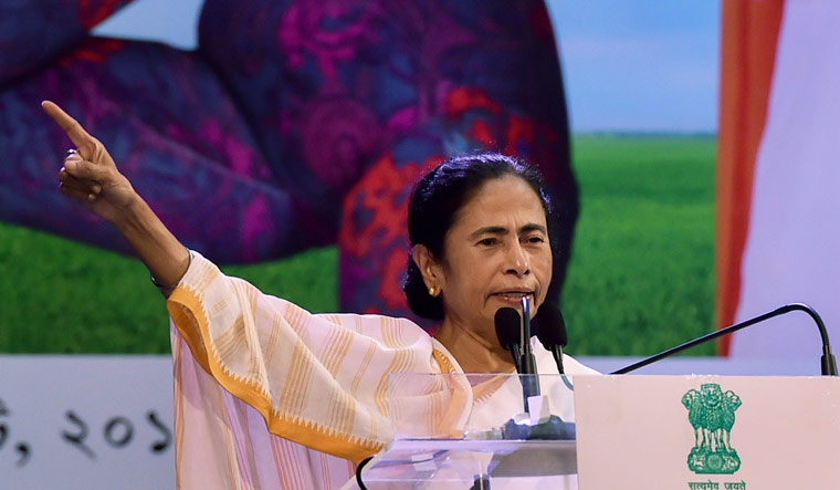 West Bengal Chief Minister Mamata Banerjee addresses during the 5th anniversary celebration of 'Kanyasree Diwas' at Netaji Indoor Stadium, in Kolkata | PTI