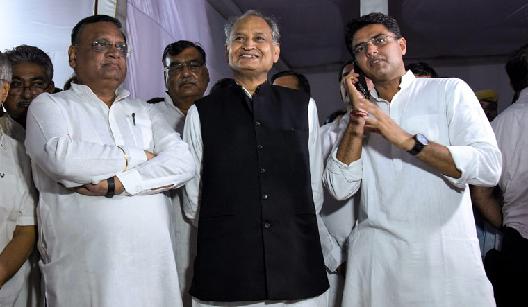Former Rajasthan chief minister Ashok Gehlot (C) with Rajasthan Congress chief Sachin Pilot (R) | PTI