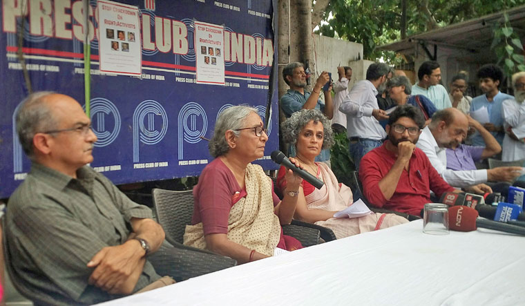 Prashant Bhushan, Aruna Roy, Arundhati Roy and Jignesh Mevani addressing a press conference protesting against the arrests of activists in New Delhi on Thursday | Arvind Jain