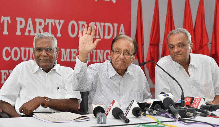 CPI General Secretary Sudhakar Reddy (Centre) with party leaders D. Raja and K. Narayan, during a press conference in New Delhi | Sanjay Ahlawat