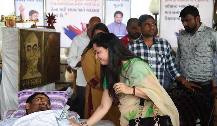 [File] Pooja Chabbra, daughter-in-law of Rajasthan's social activist late Gurcharan Chabbra, greets Hardik Patel during his hunger strike in Ahmedabad on Friday | AFP