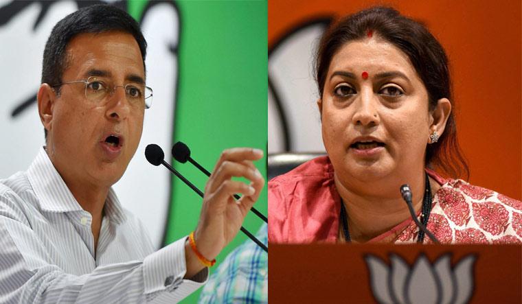 AICC Communications Department head Randeep Surjewala (L) and Union minister Smriti Irani