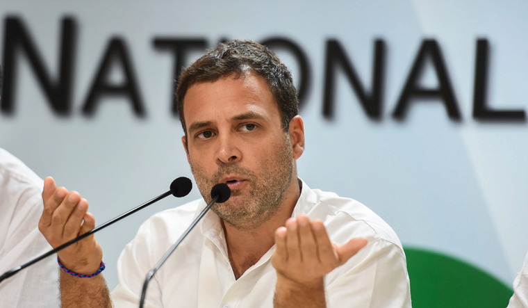 [File] Congress president Rahul Gandhi gestures while addressing the media on Rafale deal issue, in New Delhi, Saturday | PTI