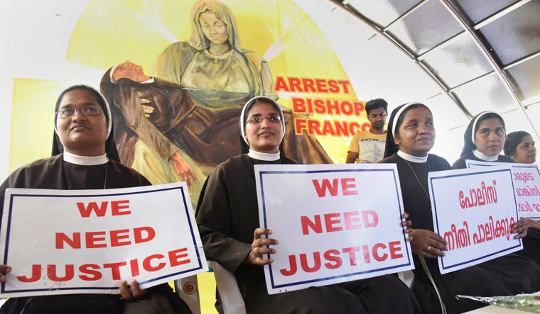 Nuns protest against the alleged delay in action on a Roman Catholic church bishop, who is accused of sexually exploiting a nun, in Kochi | PTI