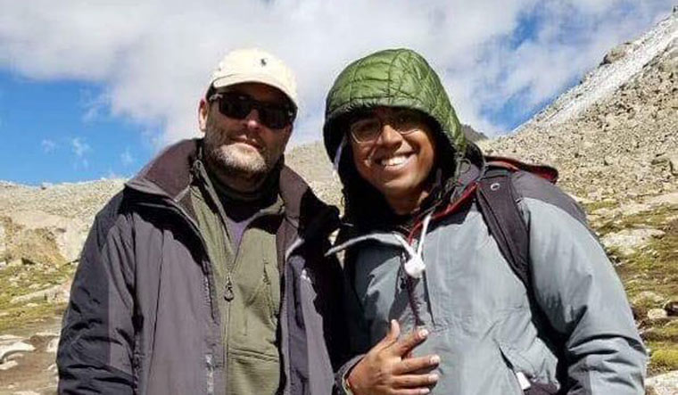 Rahul poses for photo along with a fellow traveller against the backdrop of a snow-clad mountain | Twitter/girirajsinghbjp