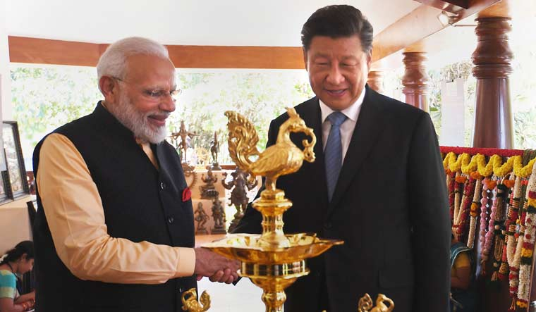 Prime Minister Narendra Modi with Chinese President Xi Jinping, at Fisherman's Cove in Kovalam near Mamallapuram | PTI