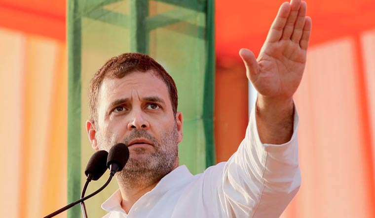 Congress leader Rahul Gandhi gestures as he speaks during an election campaign rally ahead of Assembly polls in Mahendergarh district of Haryana | PTI