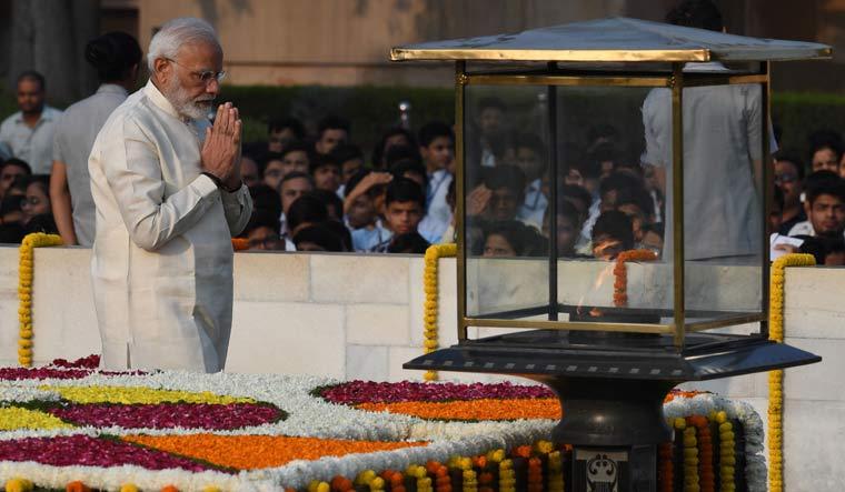 PM Modi pays homage to Mahatma Gandhi at Rajghat