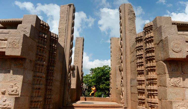 [File] Visitors walk past 'Raya Mandapam' monument at Mahabalipuram | AFP