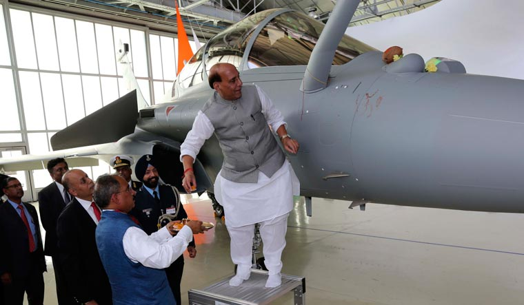 [File] Defence Minister Rajnath Singh performing a puja on the first Rafale for the IAF | PTI