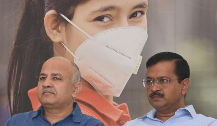 Delhi Chief Minister Arvind Kejriwal with Deputy Chief Minister Manish Sisodia during distribution of anti-pollution mask among students at Rajkiya Pratibha Vikas Vidyalaya | PTI