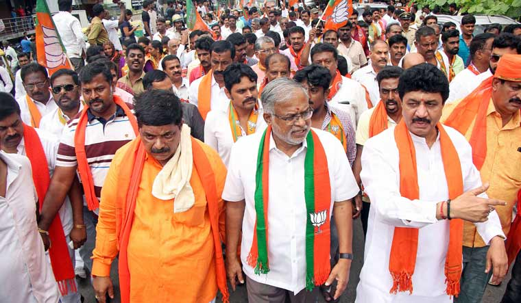 Karnataka's Education Minister Suresh Kumar during a road show in support of K. Gopalaiah, BJP's candidate for Mahalaxmi Layout constituency, on their way to file the nomination papers for assembly by-elections, in Bengaluru | PTI