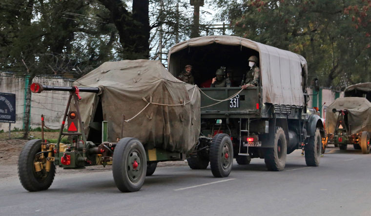 Indian Army artillery vehicles drive on a highway in Akhnoor   AP