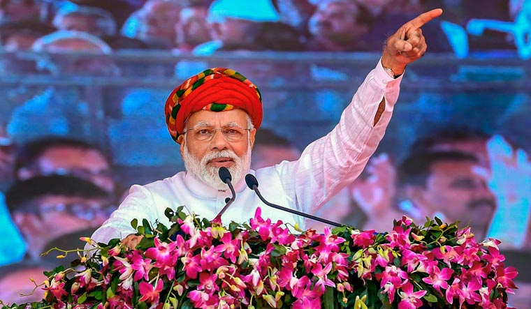Prime Minister Narendra Modi speaks at the inauguration of the various development projects, in Jamnagar | PTI