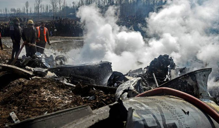 [File] Fire fighters dousing flames at the site where an MI-17 chopper of the IAF crashed in Budgam | PTI