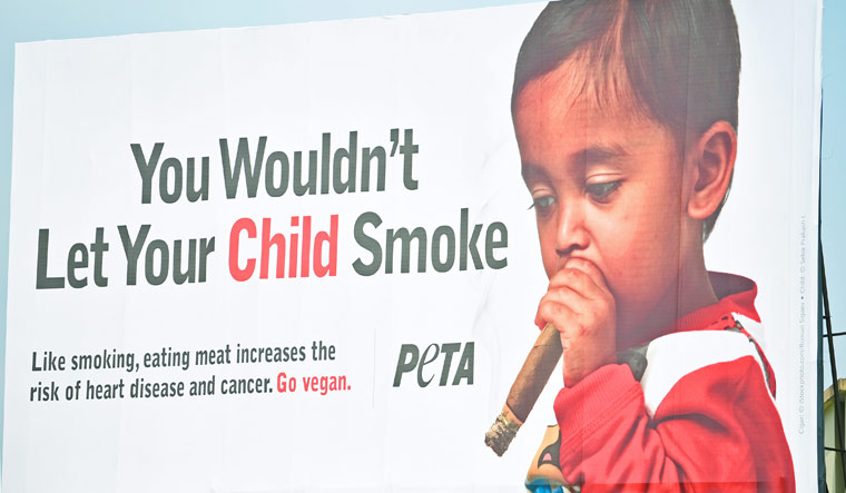 PETA has chosen the photograph of a small kid with a cigarette stub on his mouth to promote vegetarianism