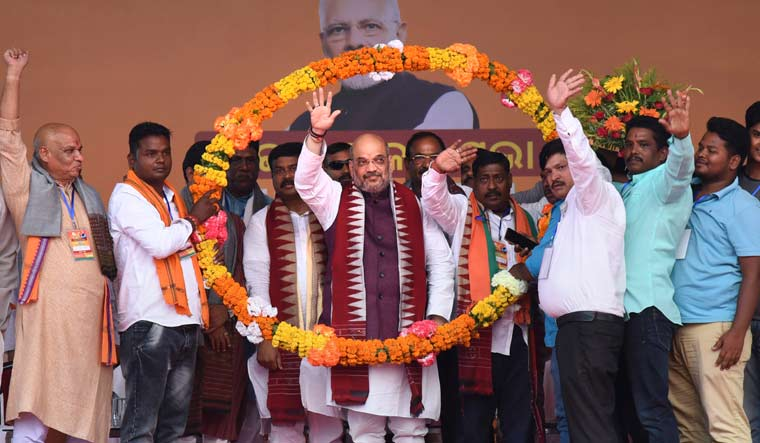 BJP president Amit Shah being garlanded by party leaders at 'Vijay Sankalp Sabha', an election campaign for the Lok Sabha polls, at Narasinghpur in Cuttack | PTI