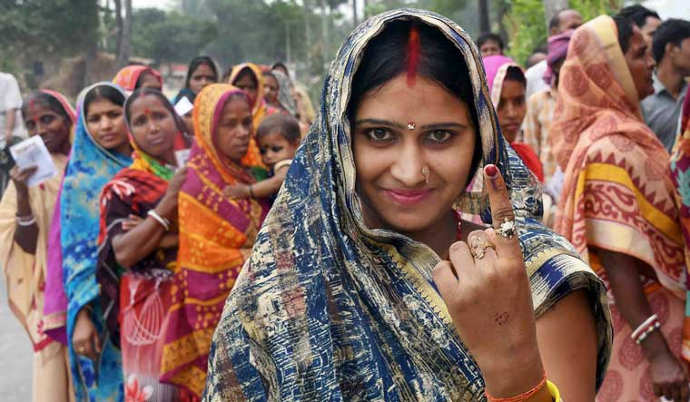 A voter shows her inked marked finger after casting vote during the 4th phase of the 2019 Lok Sabha elections, at polling station in Samastipur | PTI