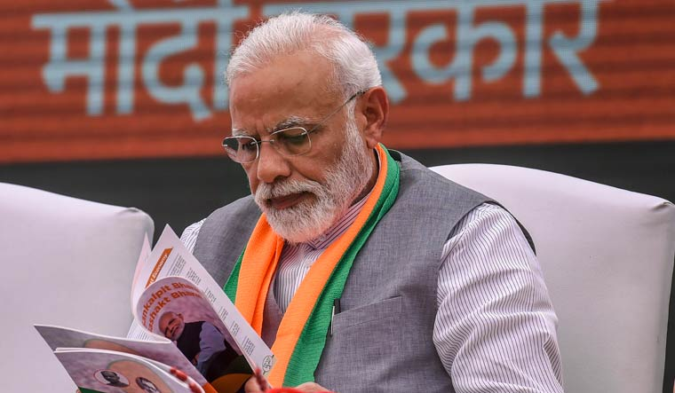 Prime Minister Narendra Modi after releasing the BJP manifesto (Sankalp Patra) for Lok Sabha elections 2019, in New Delhi | PTI