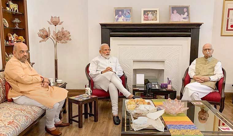 Prime Minister Narendra Modi and BJP president Amit Shah meet party's senior leader L.K. Advani | PTI