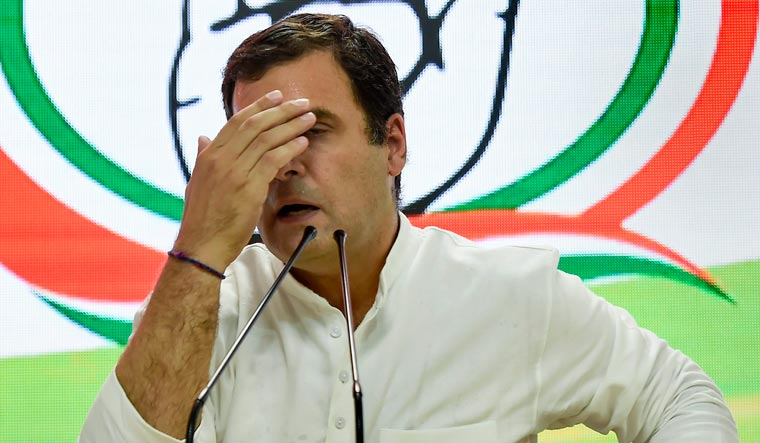 [File] Congress president Rahul Gandhi reacts as he addresses a press conference on Lok Sabha polls results at the party headquarters in New Delhi on Thursday | PTI