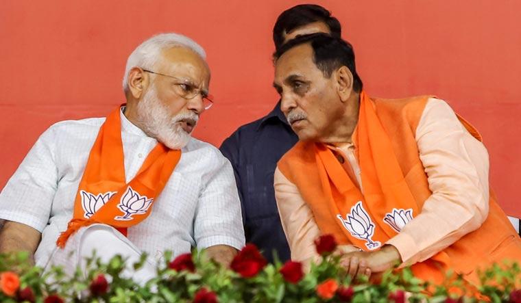 [File] Prime Minister Narendra Modi with Gujarat Chief Minister Vijay Rupani | PTI