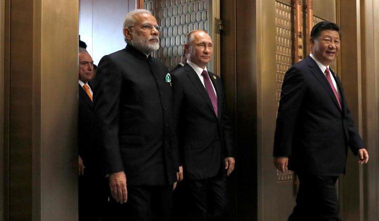 [File] Prime Minister Narendra Modi, Russian President Vladimir Putin and Chinese President Xi Jinping | Reuters