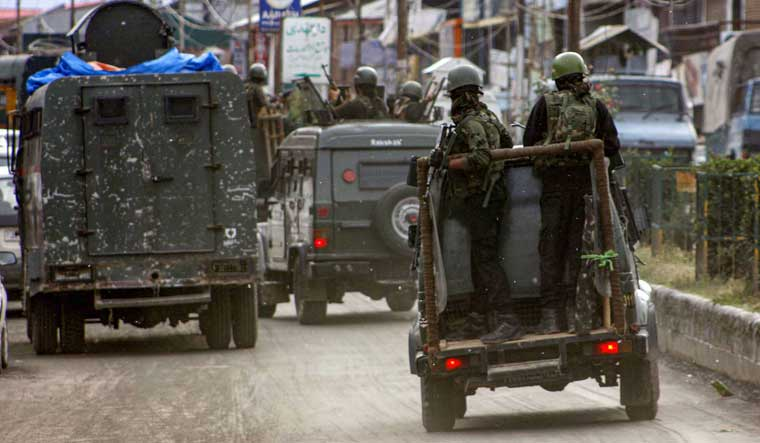 Security personnel near the site of a terrorist attack, in which five CRPF personnel and one militant were killed and four others including an SHO were injured, in Anantnag | PTI