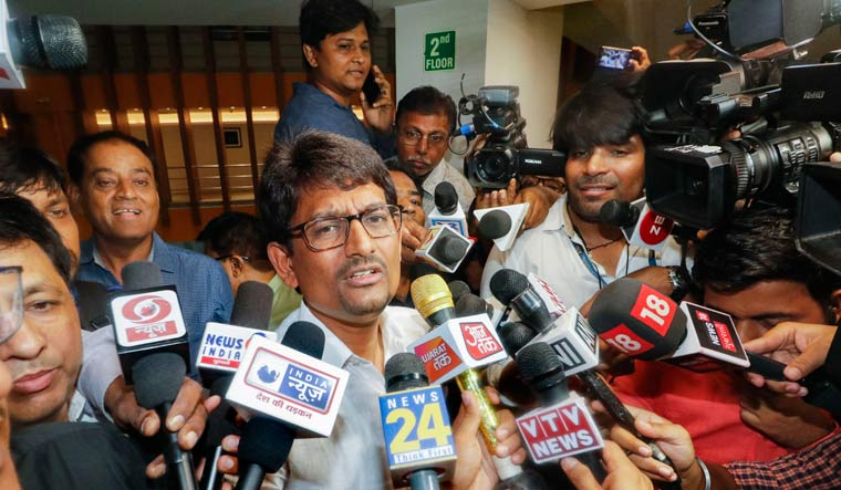 Congress MLA Alpesh Thakor addresses the media after submitting his resignation to the Speaker | PTI