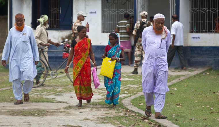 [File] Villagers return from a National Register of Citizens (NRC) centre after checking for their names on the final list in Pabhokati village in Morigaon district in Assam | AP