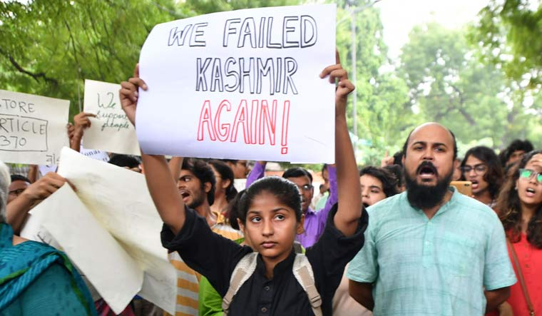 A group of people protest in Delhi against the scrapping of Article 370 which gives special status to Jammu and Kashmir | Arvind Jain