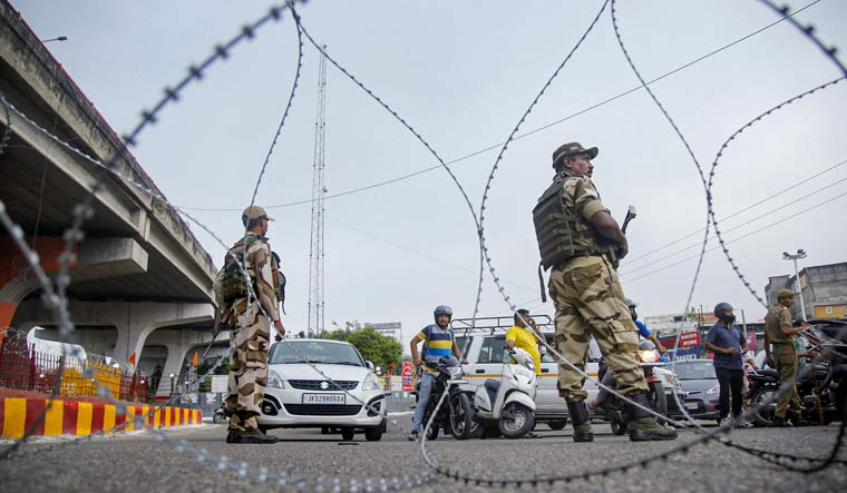 Security personnel stand guard during restrictions in Jammu | PTI