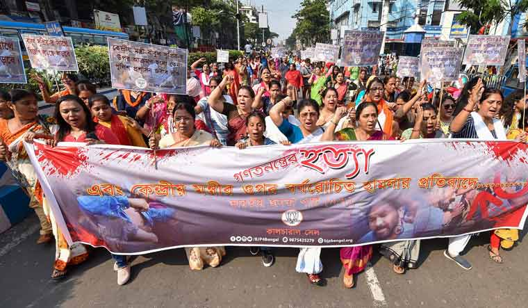 BJP supporters raise slogans during a rally to protest against the assault on Union Minister Babul Supriyo at Jadavpur University in Kolkata | PTI