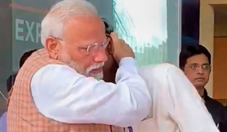 Prime Minister Narendra Modi consoles ISRO Chairman Kailasavadivoo Sivan as he got emotional after the Vikram lander connection was lost during soft landing of Chandrayaan 2 on lunar surface | PTI