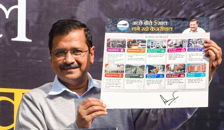Arvind-kejriwal-guarantee-card-delhi-elections-PTI