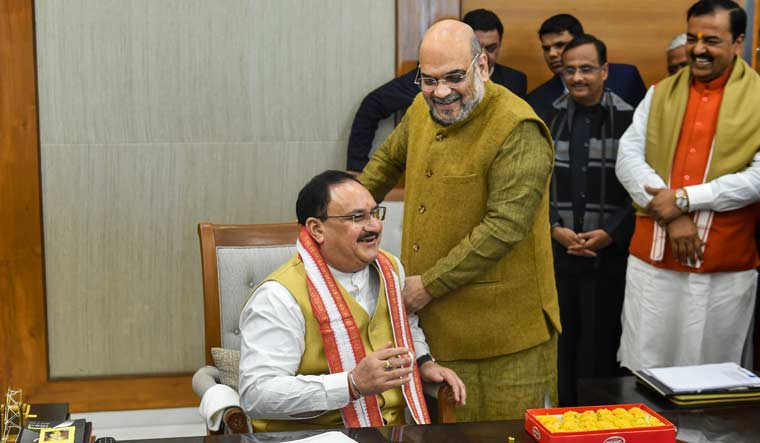 Union Home Minister Amit Shah greets J.P. Nadda, as the latter formally takes charge as BJP national president after being elected unopposed, at party headquarters in New Delhi   PTI