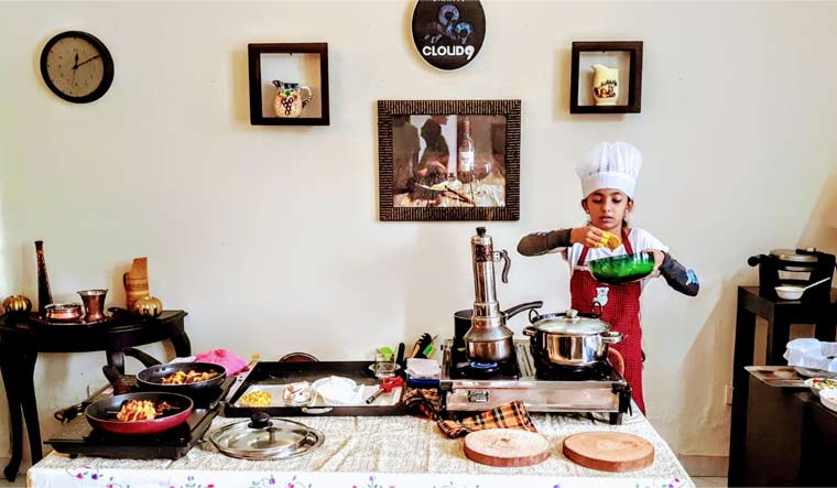10-year-old daughter of Wing Commander cooks 30 dishes, makes it to record books