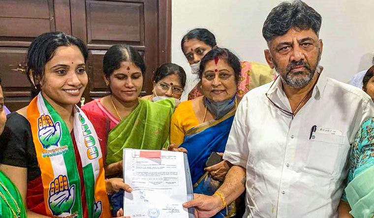 KPCC President D.K. Shivakumar presents B-Form to Kusuma H., widow of deceased IAS officer D.K. Ravi, ahead of Assembly bypolls, in Bengaluru | PTI
