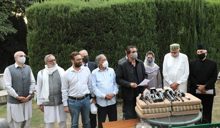 Members of People's Alliance for Gupkar Declaration address a press conference after their meeting at Bathindi in Jammu | PTI