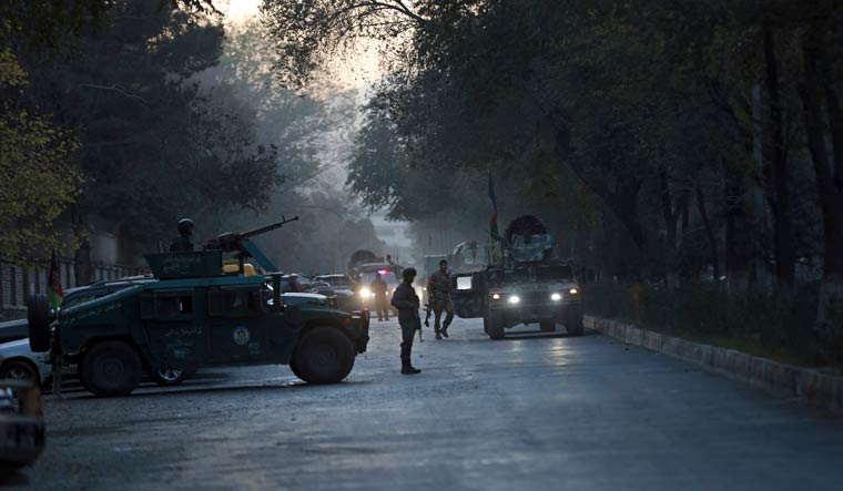 Afghan security personnel patrol at the site of an attack at Kabul University in Kabul on November 2 | AP