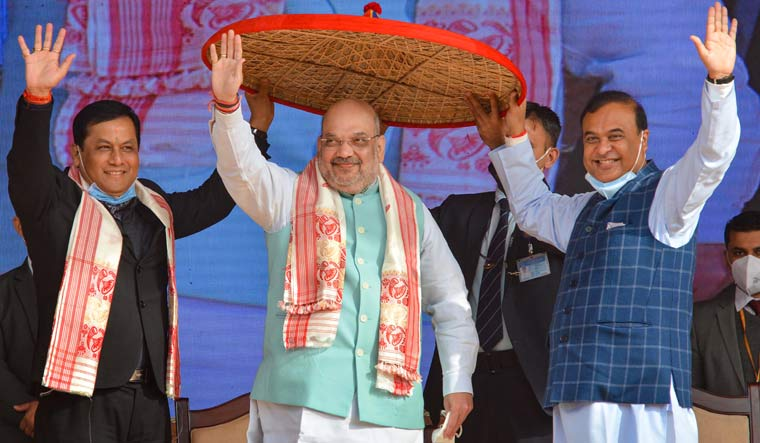 Union Home Minister Amit Shah felicitated by Assam Chief Minister Sarbananda Sonowal and Assam Finance Minister Himanta Biswa Sarmah during the ceremonial program for 'Assam Darshan', at Amingaon in Kamrup district   PTI