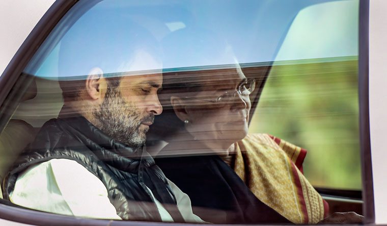 Congress president Sonia Gandhi along with Rahul Gandhi leaves Parliament House after attending proceedings during the Budget Session on Tuesday | PTI