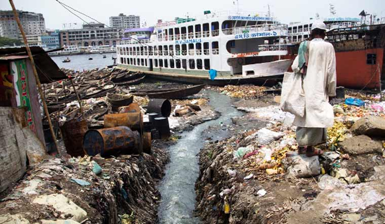 A man walks on the banks of the Buriganga River in Dhaka, a river that gave life to the city but now gasps for life due to massive pollution and illegal grabbing | Stephan Uttom/UCA News