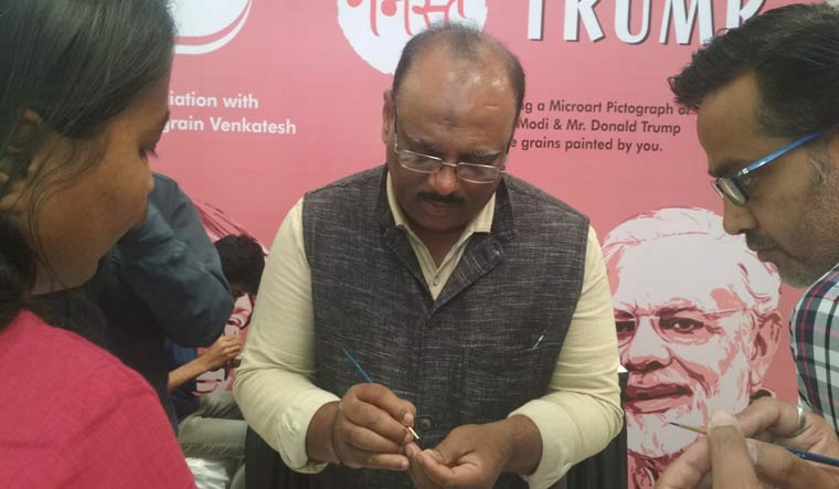 Rice grain artist Venkatesh Shyanuvhog at Ahmedabad One Mall in Ahmedabad   Nandini Oza