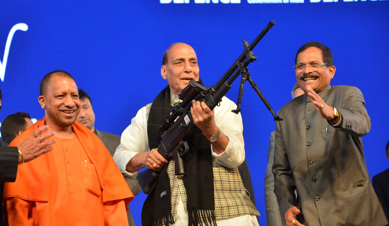 Defence Minister Rajnath Singh with Minister of State for Defence Yesso Naik and Uttar Pradesh Chief Minister Yogi Adityanath trying his hands at LMG 7.62 mm Belt Fed | Arvind Jain