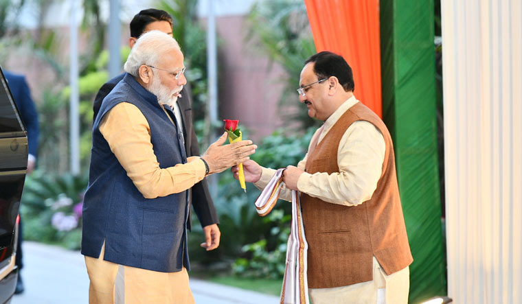 Prime Minister Narendra Modi is greeted by BJP president J.P. Nadda as he arrives at the BJP office for the CEC meeting   Sanjay Ahlawat