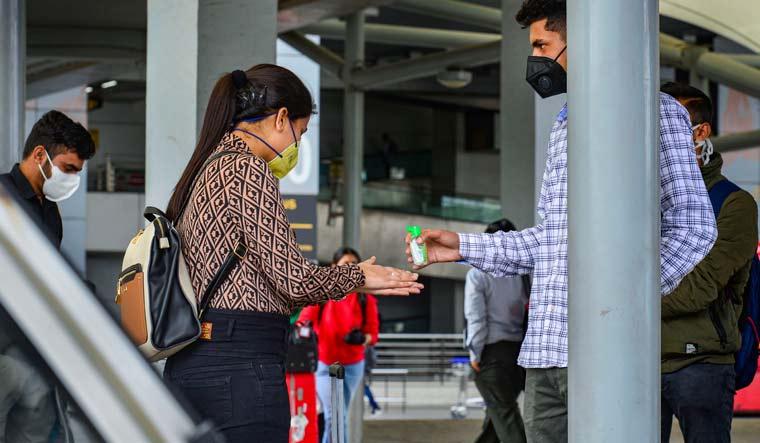 delhi airport sanitiser rep pti