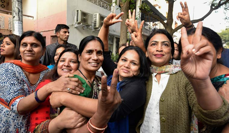Nirbhaya rape and murder case victim's mother (C) is greeted by friends and relatives after four men convicted of the crime were executed inside Tihar jail | PTI