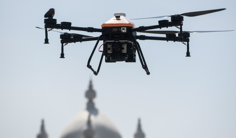 A drone sprays disinfectant at the compound of a municipal office during a government-imposed lockdown as a preventive measure against the COVID-19 coronavirus in Chennai | AFP